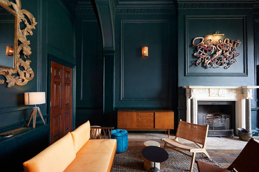 The Birch waiting room painted in a dark blue
